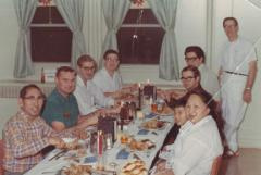 Warren Neakok sitting down for a meal with friends and family