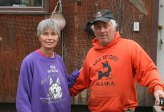 Pam and Joee Redington in front of their house in Manley Hotsprings.